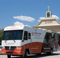 Mobile Wellness clinic bus in front of church