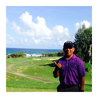 Greg on a golf course in Hawaii