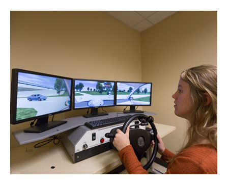 Woman in a driving simulator