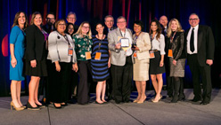 A group of Phillie award winners pose on stage with Senior Vice President for Philanthropy, Fred Najjar