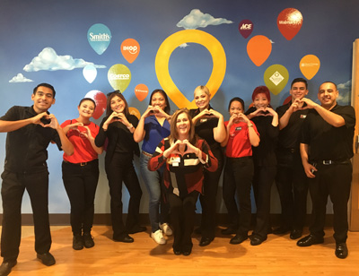Employees at Dignity Health St. Rose Dominican's Pediatric Centers make the hand-heart gesture