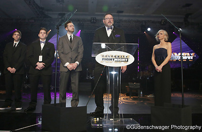 Speakers on stage share stories at Celebrity Fight Night